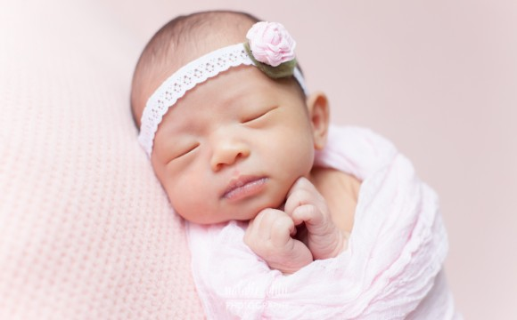 Wrapping up a newborn baby photography session